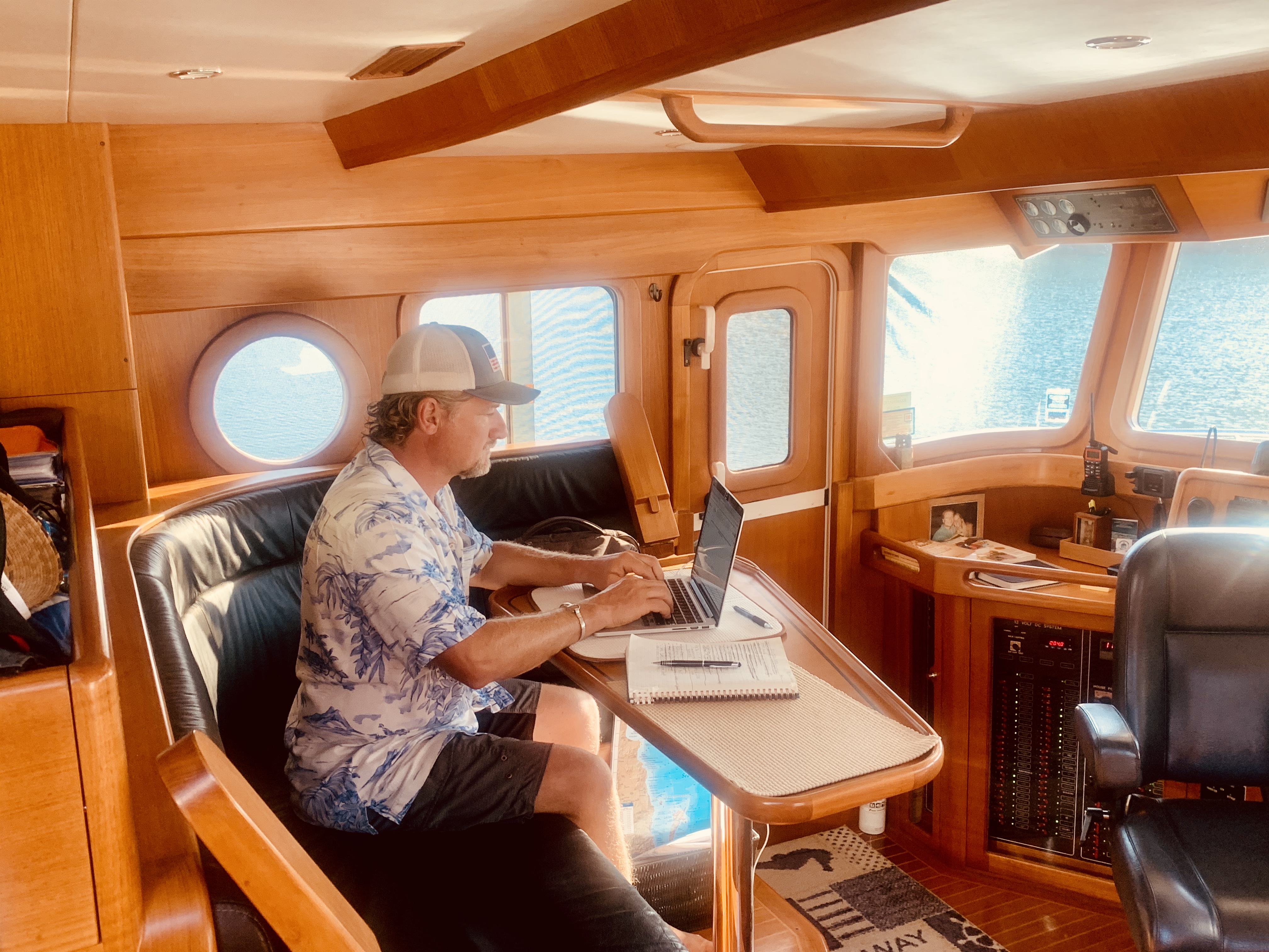 Rob working from the pilothouse aboard Selene 55, Bella Luna.