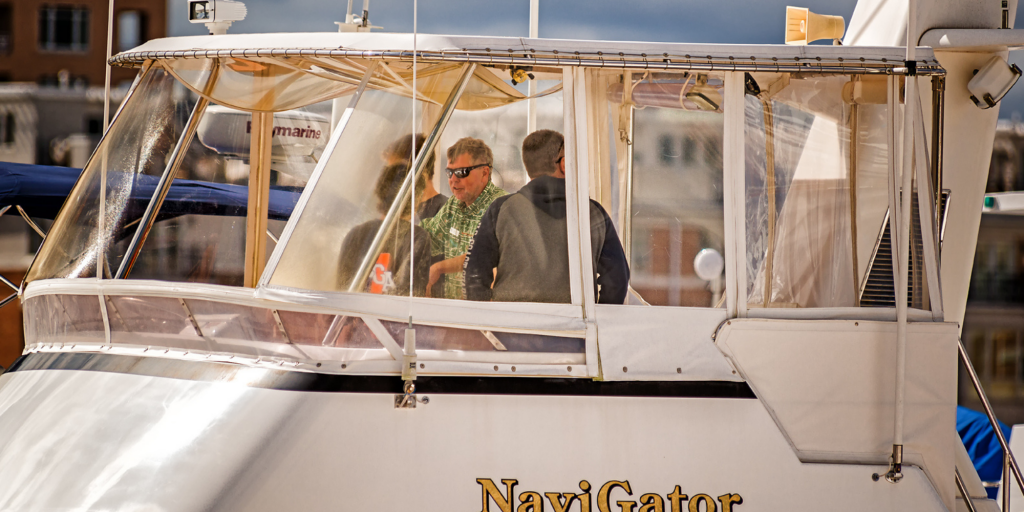Jeff Merrill and team on a boat